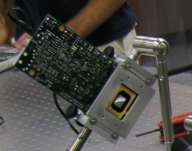 Diffractive wavefront control using a digital micro mirror for Mirror micro projector